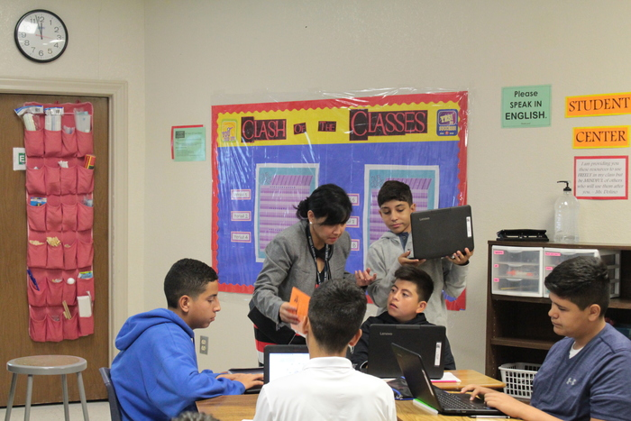 Ms. Dolino assisting her students