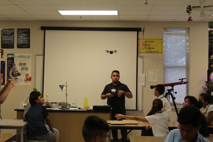 Mr. Amaro flying the drone in the classroom.